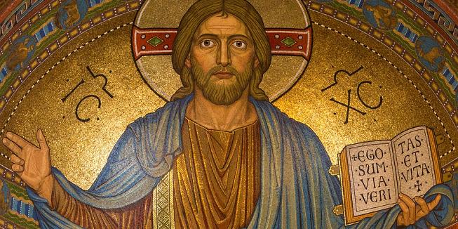 Religie: Afbeelding van Jezus Christus met een bijbel.