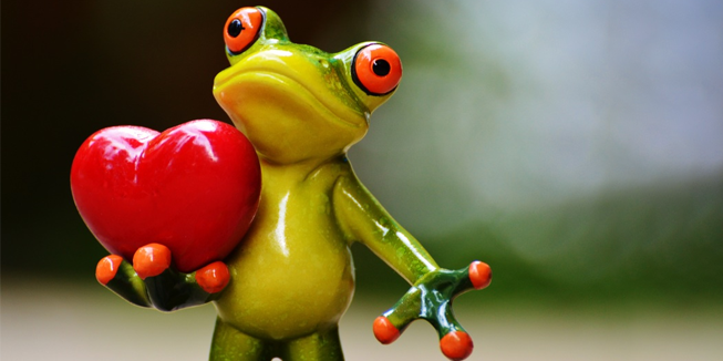 Een kikker geeft een hart.